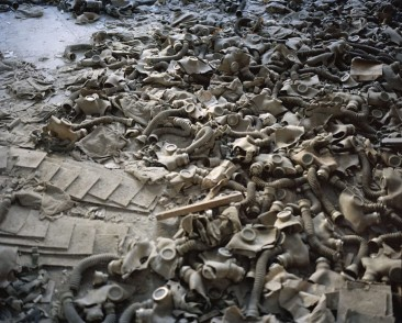 Rena Effendi Gas masks, the floor of a school lobby in the abandoned city of Prypiat. As a result of the nuclear accident and subsequent radioactive fallout the entire population of Prypiat was evacuated and never returned home