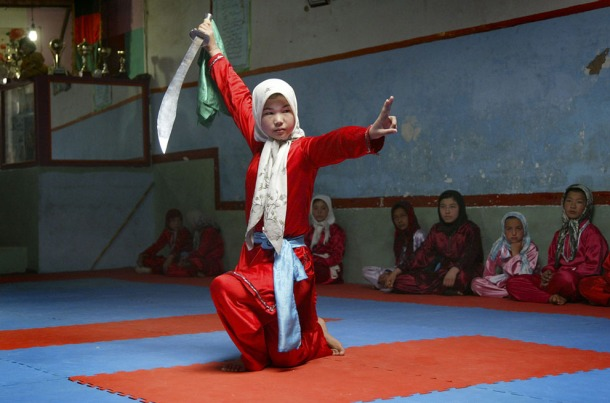 An Afghan girl practices the martial arts with a sword at a Wosho training club in Injil, Herat province, on April 6, 2011. (AP Photo)