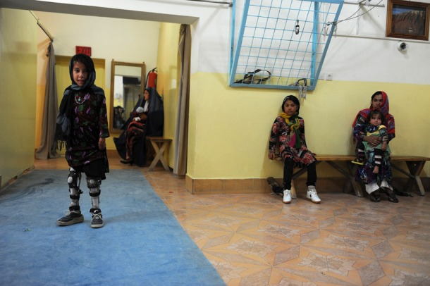 A young amputee practices walking with her prosthetic legs at an International Committee of the Red Cross hospital for war victims and the disabled in the city of Mazar-i-Sharif, on May 1, 2013. (Farshad Usyan/AFP/Getty Images)