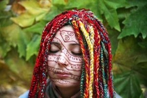 Khas typically uses henna and fabric weave on her body in an outdoor setting