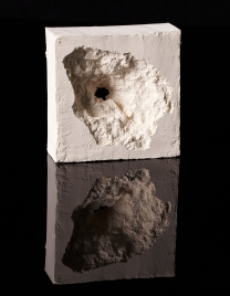Painting Of A Taliban Bullet Hole. 2011. Piers Secunda. Edition of 10 plus 4 artists' proofs. Industrial floor paint. 9.5x9.5x3.5cm